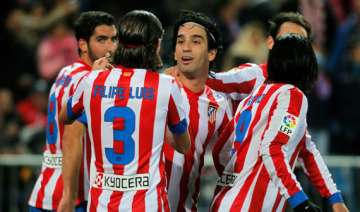 atletico wins 1 0 at granada to stay in 2nd place...