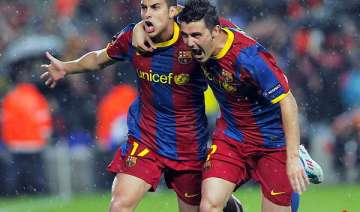 barcelona ousts real madrid to enter uefa...
