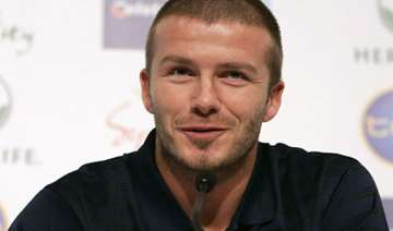 beckham says playing for mourinho would be a...