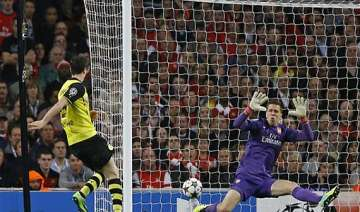 champions league chelsea back on track arsenal go...