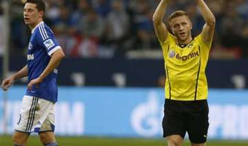 dortmund wins ruhr derby with 3 1 win at schalke...