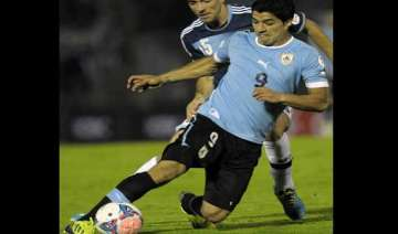 fifa world cup suarez jogs on field for first...