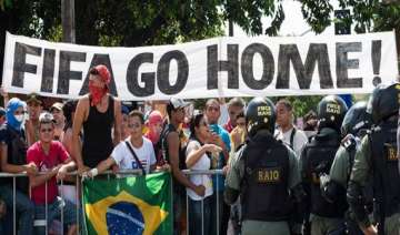 fifa world cup small band of protesters marches...