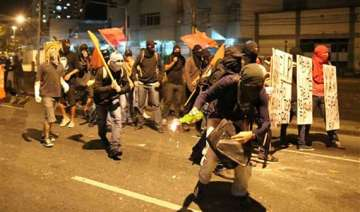 fifa world cup police fire tear gas at protesters...