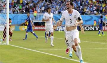 fifa world cup uruguay edges italy 1 0 to advance...