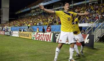 fifa world cup colombia tops group c by beating...