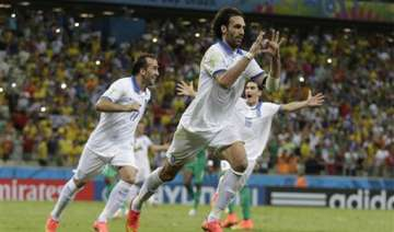 fifa world cup greece advances to next round...