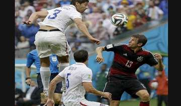 fifa world cup germany tops group on muller s...