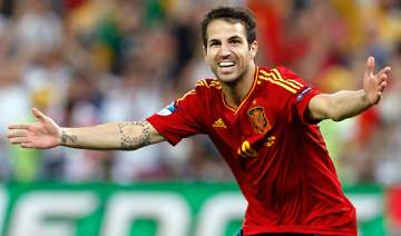 fabregas delivers again with penalty for spain -...