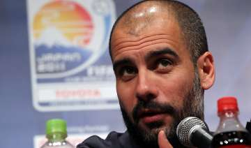 guardiola wants relaxed barca at club world cup -...