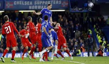 chelsea into league cup final after fiery win...