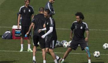 injury hit madrid hosts atletico in champions...