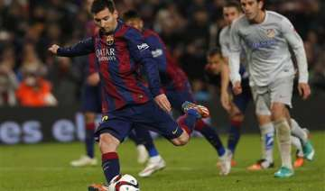 messi scores late as barcelona beats atletico 1 0...
