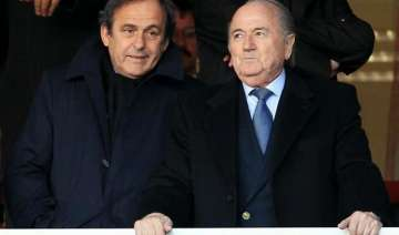 fifa reduces ban on sepp blatter and michel...