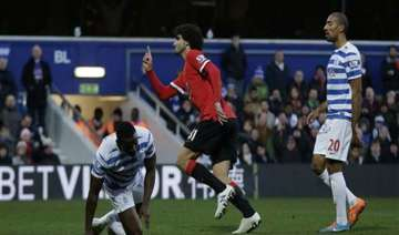 man united beats struggling qpr 2 0 in premier...