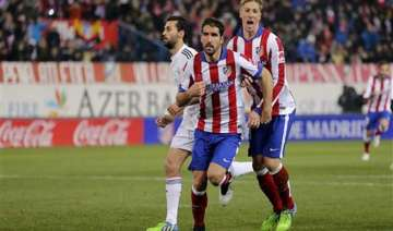 atletico beats madrid 2 0 in copa as torres makes...