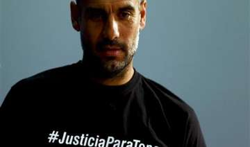 uefa charges bayern coach guardiola over t shirt...