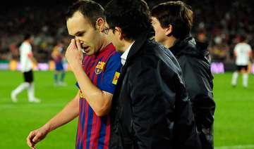 iniesta out for at least 2 weeks with thigh...