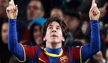 lionel messi fires barcelona into champions...