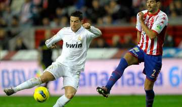 madrid beats sporting gijon 3 0 in spanish league...