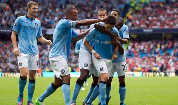 man city recovers to open title defence with win...