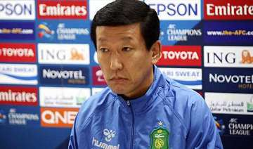 new skorea coach less than thrilled about new job...
