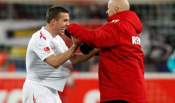 podolski snatches 1 1 draw for cologne with mainz...