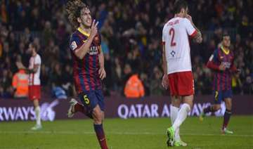 puyol to leave barcelona at end of season - India...