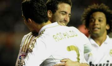ronaldo messi score as real stay clear of barca -...