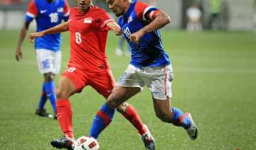 singapore beats malaysia 5 3 in world cup...