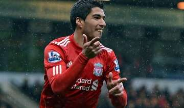 suarez scores from near halfway for hat trick -...