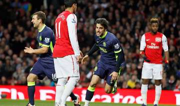 wigan beats arsenal 2 1 to boost survival hopes -...