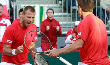 austria wins doubles to reduce spain s lead to 2...