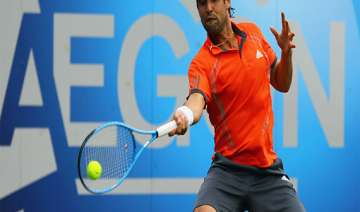 baghdatis wins in first round at eastbourne -...