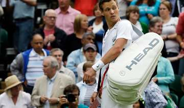 berdych loses to gulbis in 1st round of wimbledon...