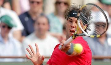 defending champion nadal wins again at french...