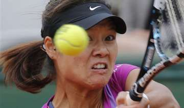 defending champion li knocked out of french open...