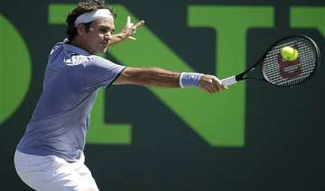federer edges karlovic with strong serve at sony...