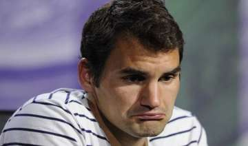 federer reflects on mistakes of playing injured -...