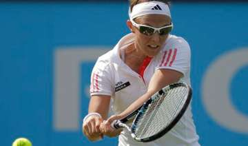 flipkens upsets stosur in 1st round at unicef...