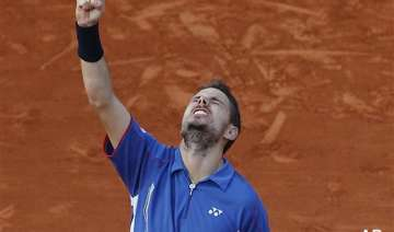 french open wawrinka fights back to reach...