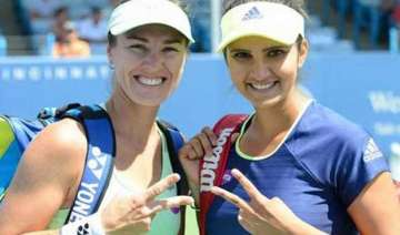 bopanna paes bow out sania mirza saves the day...