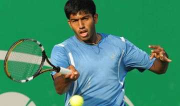 bopanna lifts madrid open trophy with florin...