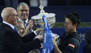 nishikori beats andujar to defend barcelona open...