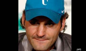 federer eases past fall to make quarterfinals -...