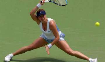 kim clijsters fights back from brink of defeat -...