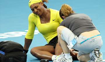 serena williams wins but injures ankle at...