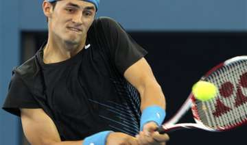tomic into kooyong final with win over monfils -...