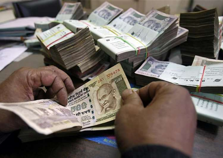 rupee falls by 20 paise vs dlr in line with stocks- India Tv