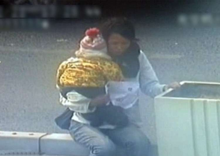 cctv footage of chinese cop saving woman kid trying to jump- India Tv